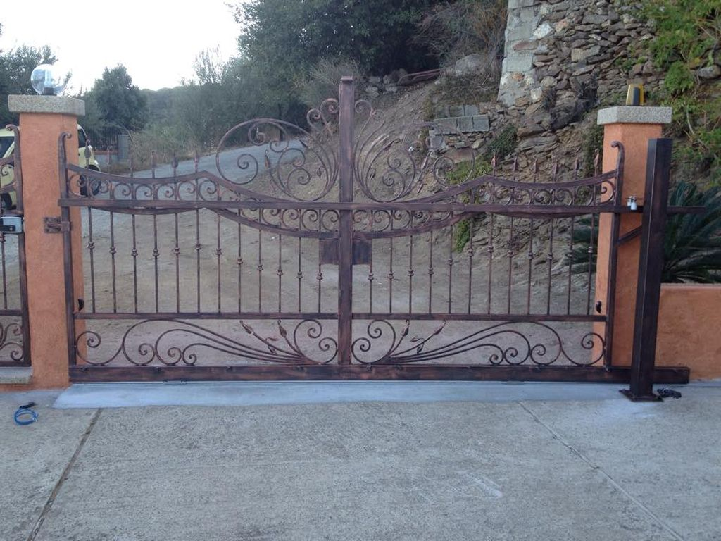 Fabbro olbia tempio cancelli in ferro battuto e acciaio inox for Cancelli ferro battuto foto